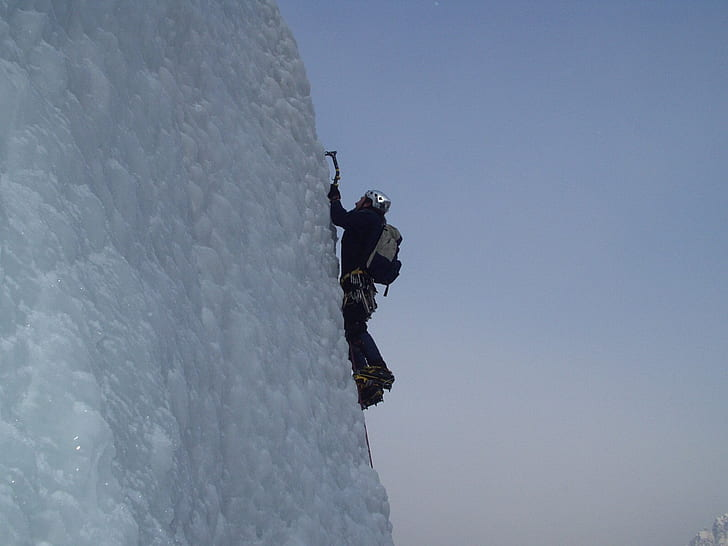 ice climber on steep slope