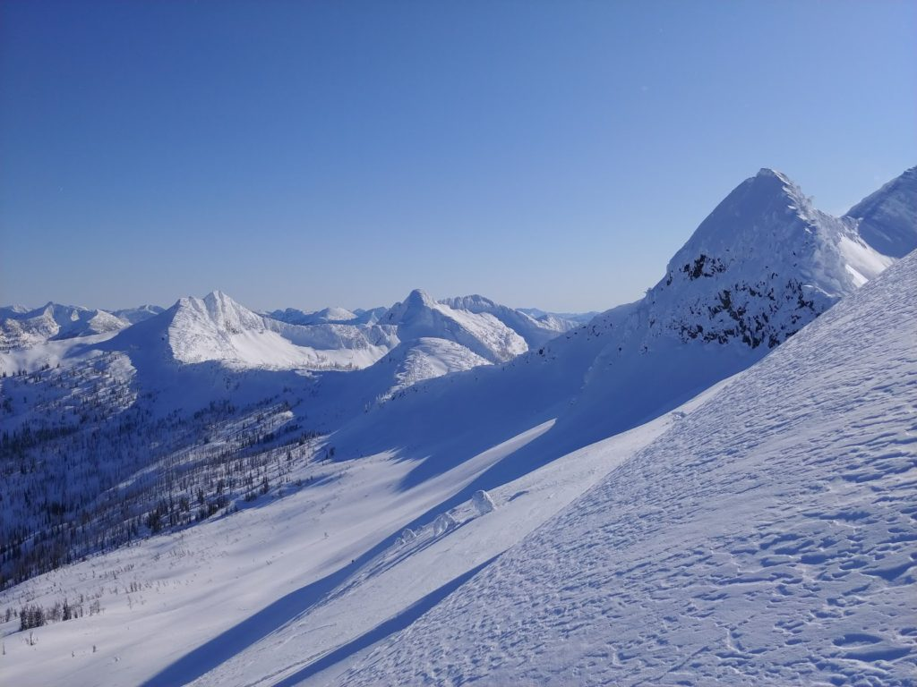 backcountry skiing blue skies and mountains