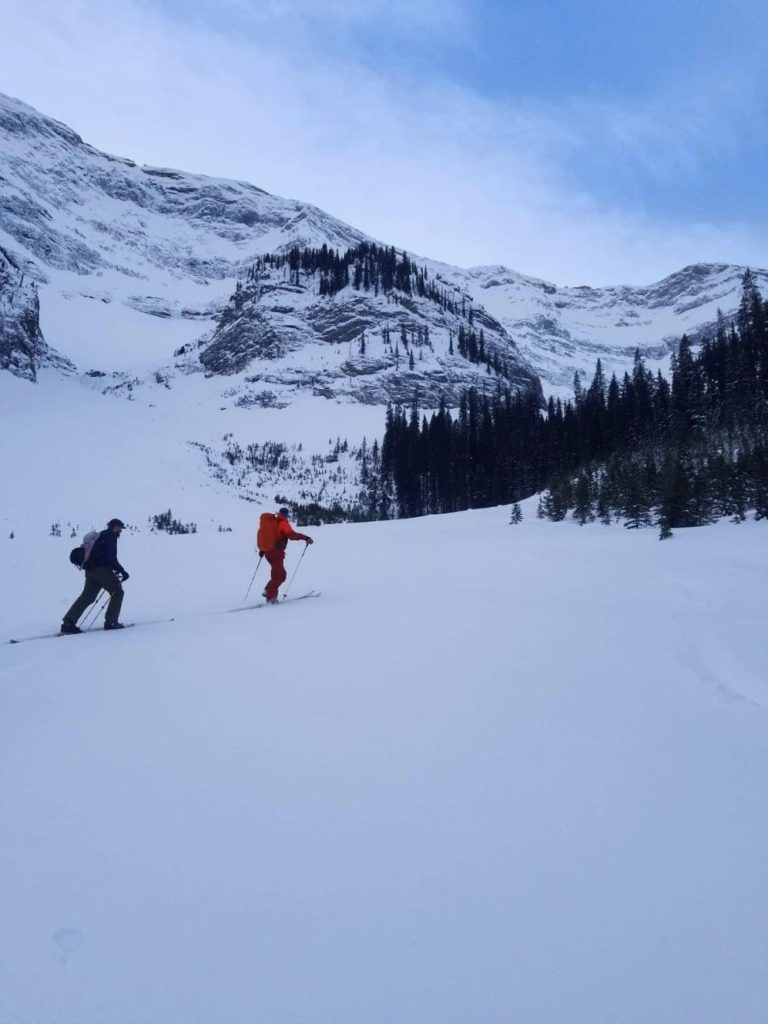 backcountry skiers on the skin track practicing good spacing etiquette