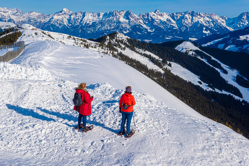 backcountry snowshoe adventurers surveying a view