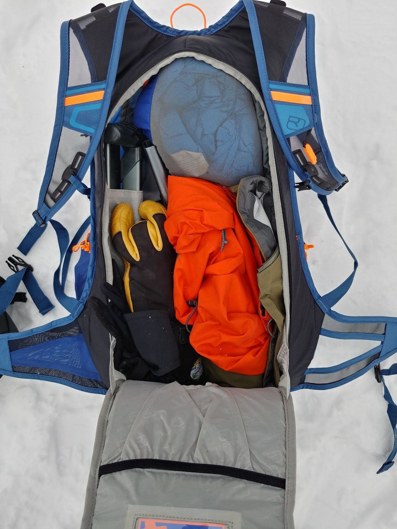 ortovox trace 25 ski touring main compartment with shell and gloves
